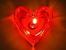glowing red heart candle