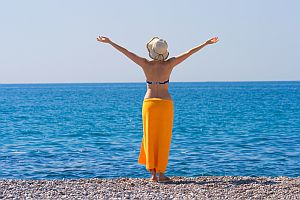 Self Trust - Woman with Outstretched Arms Overlooking Ocean