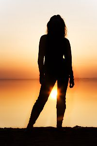 Trusting Yourself - Woman's Silhouette in Sunlight