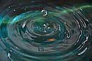 waterdrop above water ripples