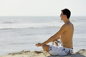 communicating-with-god-man-meditating-on-beach